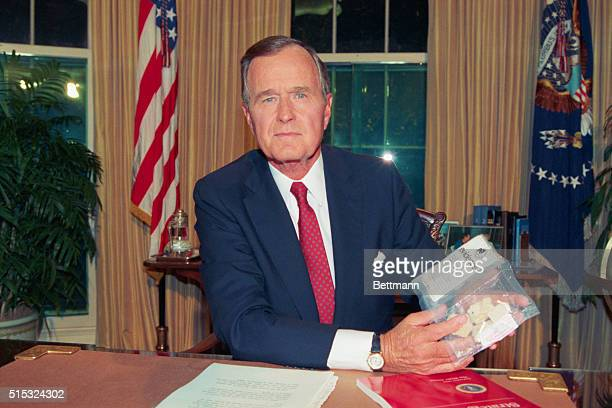 President Bush displays a bag of crack cocaine that was seized by DEA agents a few days ago in Lafayette Park across from the White House after Bush...