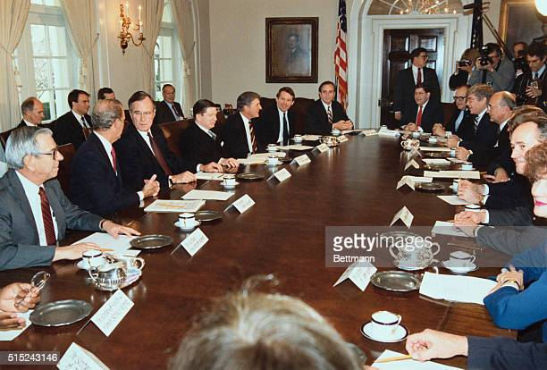 President George Bush's first cabinet meeting in the White House Cabinet room seated clockwise are Gov John Sunnu Sec Edward Derwinski Sec Jack Kemp...