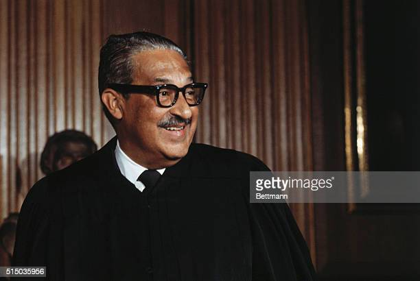 Washington D CAssociate Supreme Court Justice Swear In Thurgood Marshall in his robe prior to being sworn in as the first Negro member of the U S...