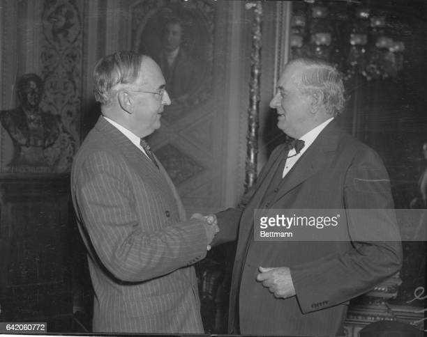 Washington D CYes And No On arms Embargo Repeal Senator Tom Connally left and Senator Arthur H Vandenberg are pictured in conversation before going...