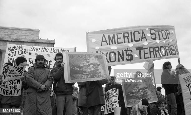 Activists line up with signs held high in front of the Lincoln Memorial in Washington DC protesting the Vietnam War and Richard Nixon's 2nd...