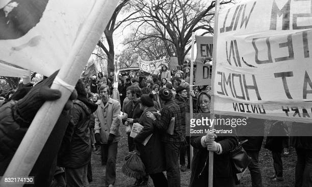 Large groups of activists holding signs gather on a lawn near the Lincoln Memorial in Washington DC in protest of the Vietnam War and Richard Nixon's...