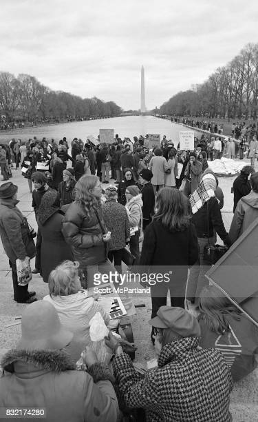 Large groups of activists line up in front of the Lincoln Memorial Reflecting Pool in Washington DC in protest of the Vietnam War and Richard Nixon's...