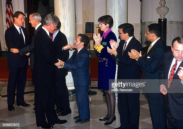 Washington DC President William Jefferson Clinton shakes hands with Secretary of Labor Robert Reich after speech in the Cross Hall of the White House...