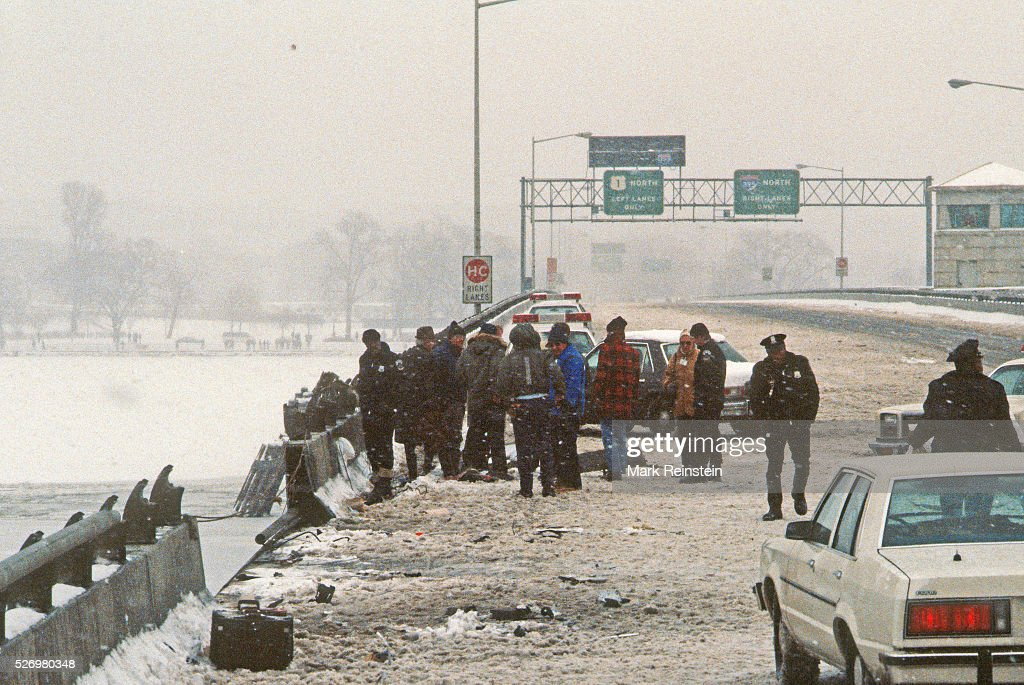 Washington, DC. 1-14-1982 On January 13, 1982, Air Florida Flight 90 crashed into Washington, DC's 14th Street Bridge and fell into the Potomac River shortly after taking off. A total of 70 passengers, 4 crew and 4 motorists on the bridge were killed. The crash of the Boeing 737-200 was due to an anti-icing system being left off. DC Police search the area on the 14th Street bridge for evidence where Air Florida Flight 90 hit before plunging into the frozen Potomac River the day before. Credit: