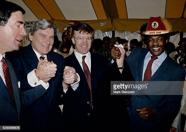 Washington DC 11984 LR Senator Charles Robb Senator John Warner Joe Gibbs coach of the 'Washington Redskins' and DC Mayor Marion Barry at reception...