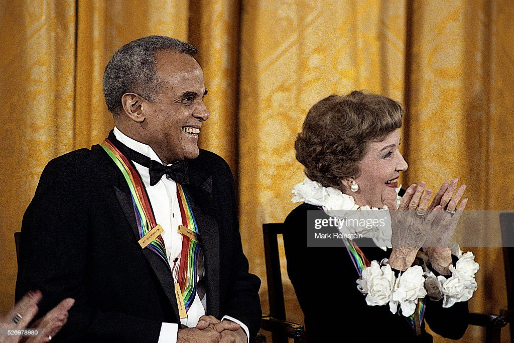 Washington, DC. 12-3-1989 Singer Harry Belafonte, film queen Claudette Colbert, two of this years Kennedy Center Honorees, laugh at a joke made by First Lady Barbara Bush during the afternoon reception in the East Room of the White House. Credit: Mark Reinstein