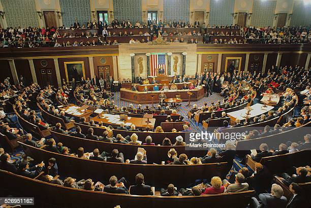 Washington DC 151993 Members of Congress and their families gather on the floor of the House of Representatives chamber on opening day of the new...