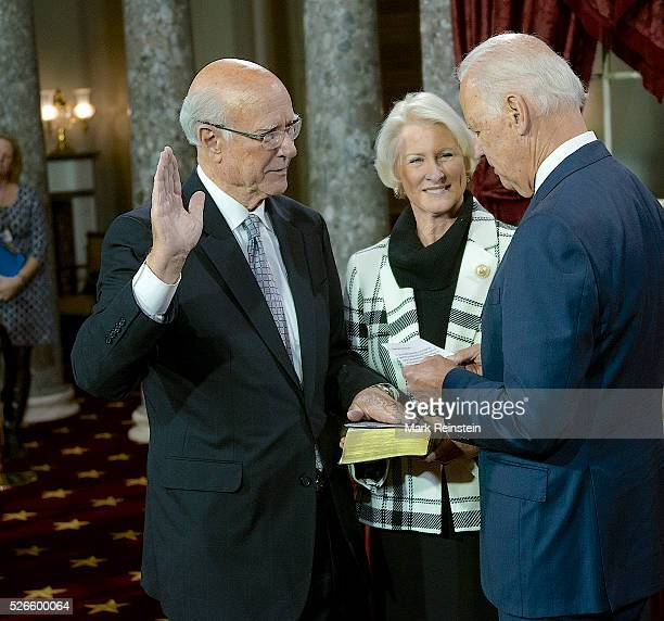 Washington DC 162015 Opening day of the 114th congress Senator Pat Roberts with his wife Frankie holding the bible is sworn in by VicePresident...