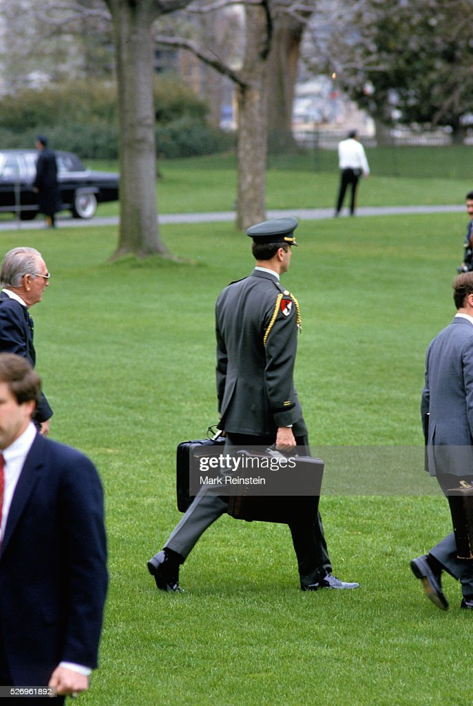 Washington, DC. 1986 Military Aid carrying the 'Black Bag' with the nuclear war codes . Credit: Mark Reinstein