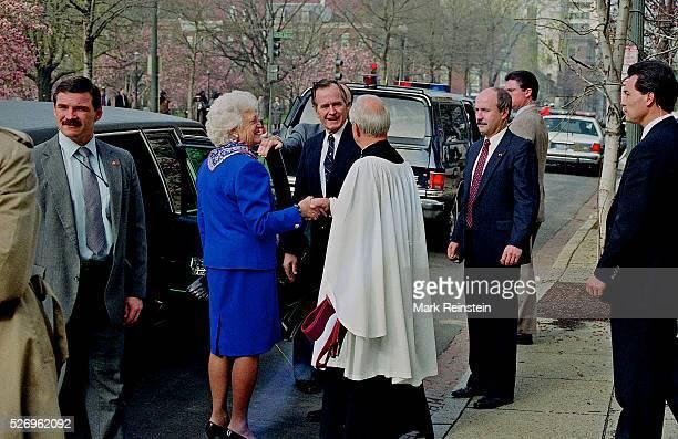 Washington DC 4121992 President George HW Bush First Lady Barbara Bush walk towards their motorcade with the Revend of St John's Episcopal Church...