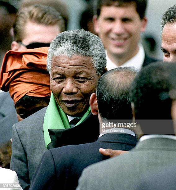 Washington DC 6241990 Nelson Mandela along with his then wife Winnie arrive at Washington DC's National Airport He is greeted by Randall Robinson the...