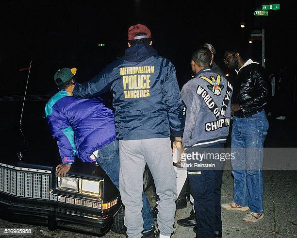 Washington, DC. 7-4-1992 DC. Police Narcotics and Homicide detectives arrest a suspect wanted in connection with a murder. Credit: Mark Reinstein