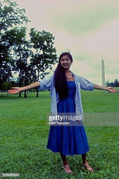 Washington DC 91981 Maya Lin stands at site of where she wants the Vietnam Veterans memorial to be placed She is holding her arms out at the angles...