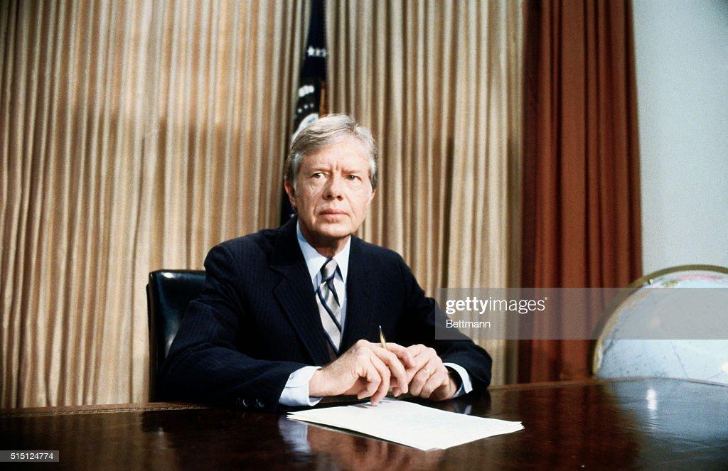 jimmy carter oval office. A Grim-faced President Jimmy Carter, Seated At Desk In Oval Office Of White Carter