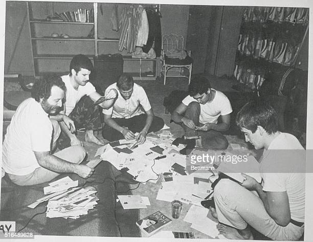 A photograph brought into the United States by an Iranian shows American reading mail in the United States Embassy in Tehran The photo is one of a...