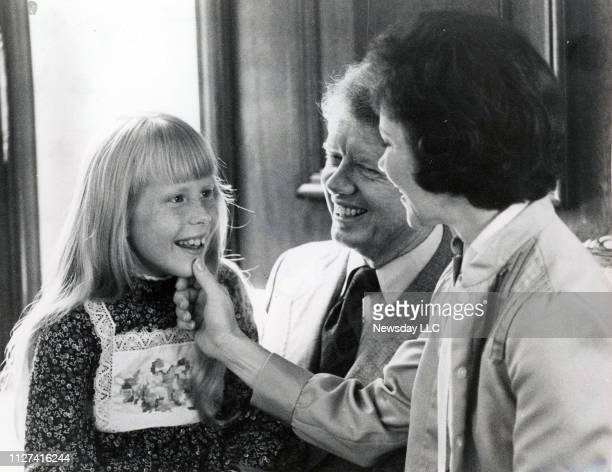 Amy Carter with her father Jimmy and mother Rosalynn Carter in a family suite at the Americana Hotel in Washington DC on July 14 1976