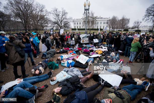 Washington DC area students and supporters protest against gun violence with a liein outside of the White House on Monday Feb 19 after 17 people were...