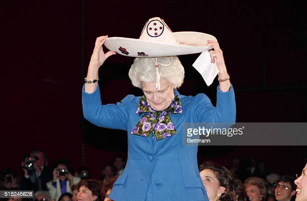 1/19/1989 Washington DC At a Kennedy Center Salute to the First Lady Barbara Bush is given a sombrero by granddaughter Noelle Bush and then tries it...
