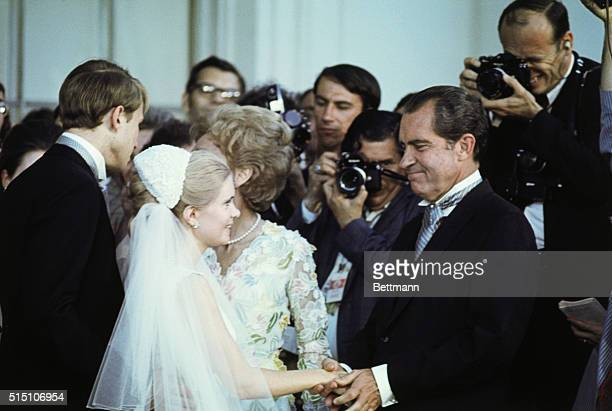 Bride Tricia and groom Edward Finch Cox bid farewell to President and Mrs Nixon as they depart for their honeymoon after the White House reception