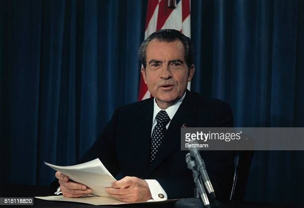 Washington DC Closeup of President Richard M Nixon seated at a desk in the Oval Office during his televised Watergate address in which he claims...