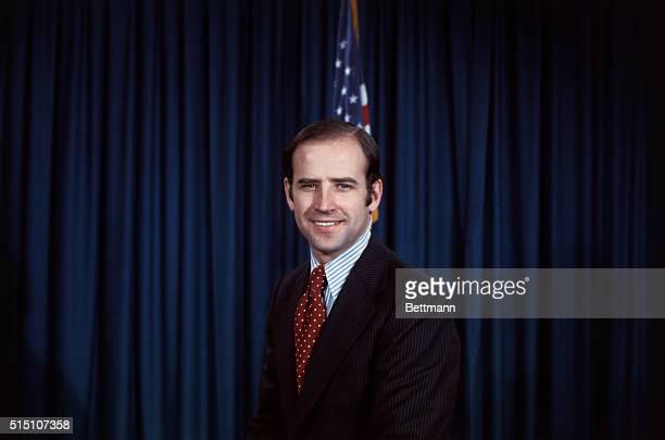 Closeups of senatorelect Joseph Biden Jr in his office smiling