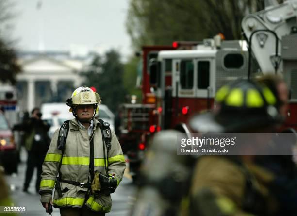 Washington DC fire battalion chief walks up 16th Street near Olives Restaurant which was the scene of a twoalarm blaze April 14 2004 in Washington DC...