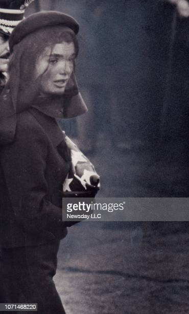 First Lady Jacqueline Kennedy holds an American flag at the funeral of her husband John F Kennedy on November 23 1963