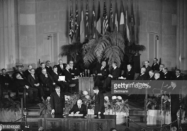 4/4/1949 Washington DC French Foreign Minister Robert Schuman signs the North Atlantic Treaty At the tabe in foreground are France's Amb to the US...