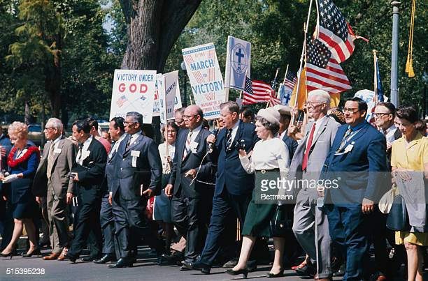 Fundamentalist preacher Reverend Carl McIntire leads March for Victory parade down Pennsylvania Avenue October 3 enroute to the Washington Monument...