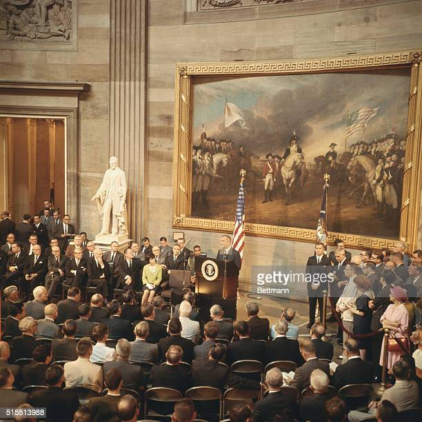 General view of the Capitol rotunda as President Johnson speaks prior to signing the Voting Rights Bill Daughter Luci sits with Vice President Hubert...