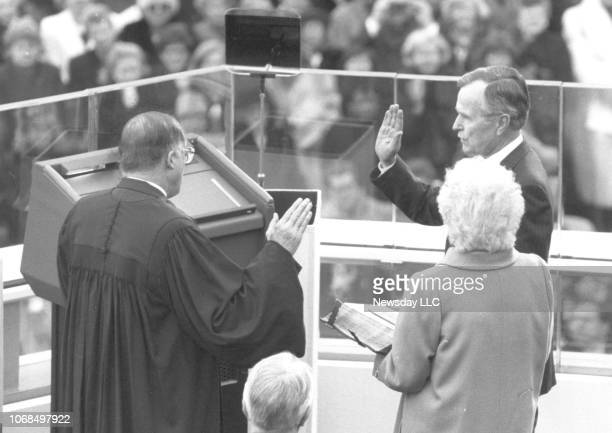 George HW Bush raised his right hand to take the oath of office from Supreme Court Chief Justice William Rehnquist and is inaugurated as America's...