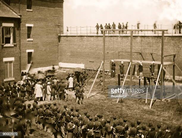 Washington, D.C. Hanging hooded bodies of the four conspirators; crowd departing on July 7th; Location today Ft. McNair, then at the Old Arsenal...