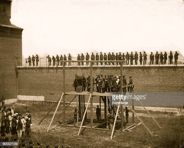 Washington DC Hanging hooded bodies of the four conspirators crowd departing on July 7th Location today Ft McNair then at the Old Arsenal...