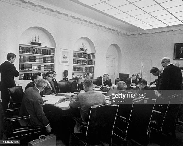 Washington, D.C.: In an historic meeting of President John Kennedy with his cabinet and advisors at the White House, this was the scene during the...