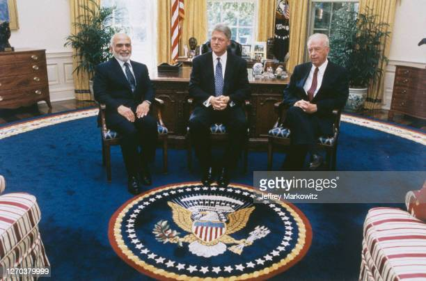 Washington DC, Israel and Jordan sign agreement ending state of war. From left to right : King Hussein of Jordan, Bill Clinton and Yitzhak Rabin at...