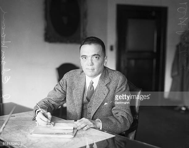 J Edgar Hoover the director of the Federal Bureau of Investigation sits at his desk in the Justice Department