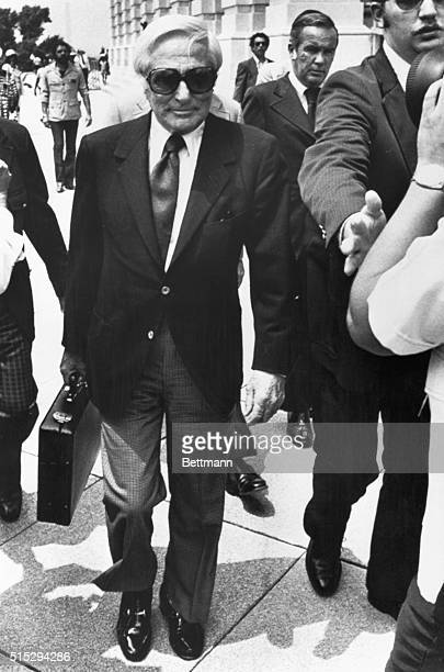 Washington, D.C.: John Roselli, a reputed underworld figure from the days of Al Capone, arrives under tight security to appear before the Senate...