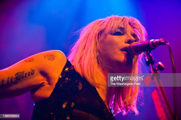 Courtney Love and Hole play a sold out show at the 930 Club in Washington DC Love behaved erratically all night including having her assistant film...