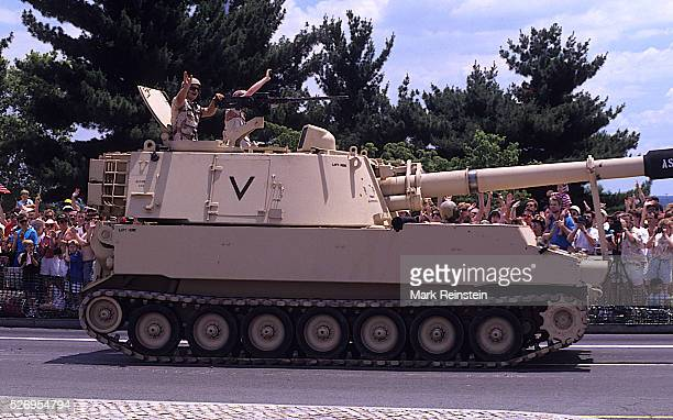Washington DC June 81991 US Army M109 Paladin 155mm SelfPropelled gun drives over the East end of the memorial bridge that leads into Arlington...