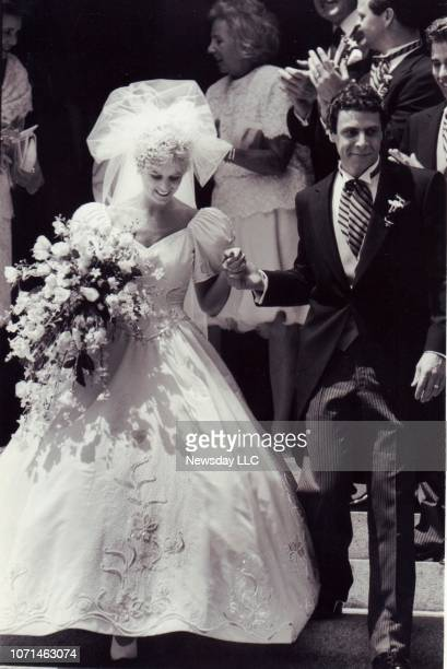 Kerry Kennedy and Andrew Cuomo walk down the steps of St Matthew's Cathedral in Washington DC after their wedding ceremony on June 9 1990