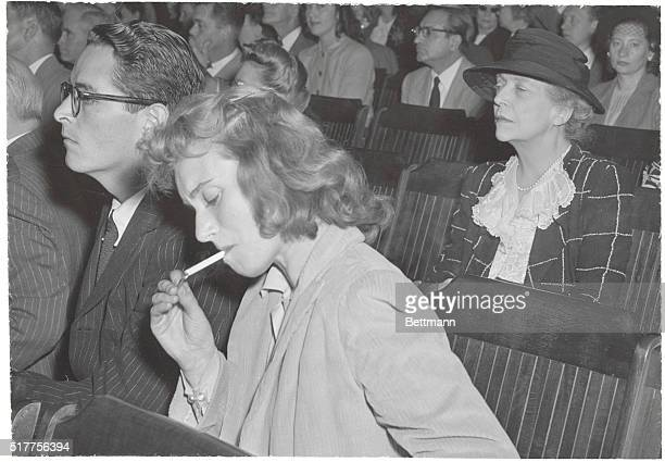 Listening To Hearings On Hollywood 'Red' Probe Ring Lardner Jr and his wife actress Frances Cheney are pictured listening to the testimony at the...