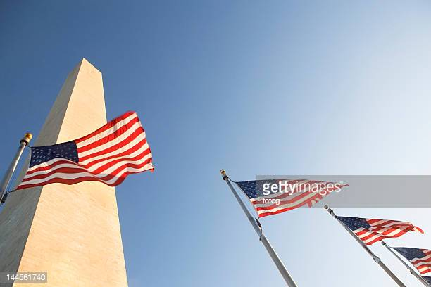 usa, washington dc, low angle view on american flags - national monument stock pictures, royalty-free photos & images
