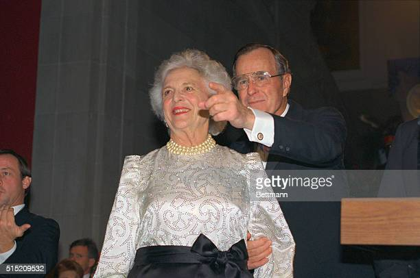 Making an appearance at the Inaugural dinner at the Corcoran Gallery of Art January 18 Presidentelect George Bush points out something of interest to...