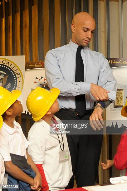 Washington DC Mayor Adrian M Fenty gets a mold of his hand made during the unveiling ceremony for the 9 new US President wax figures at Madame...