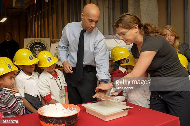 Washington DC Mayor Adrian M Fenty gets mold of his hand made during the unveiling ceremony for the 9 new US President wax figures at Madame Tussauds...