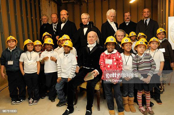 Washington DC Mayor Adrian M Fenty poses with children from Cleveland Elementary School during the unveiling ceremony for the 9 new US President wax...