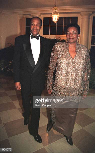 Washington DC Mayor Marion Barry and his wife Cora Masters Barry arrive at a state dinner at the White House in honor of Columbian President Andres...