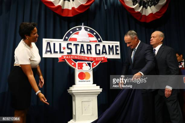 Washington DC Mayor Muriel Bowser Commissioner of Baseball Robert D Manfred Jr and Ted Lerner of the Washington Nationals pose with the new logo...