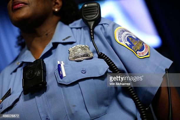 Washington DC Metropolitan Police Officer Debra Domino wears one of the new bodyworn cameras that the city's officers will begin using during a press...